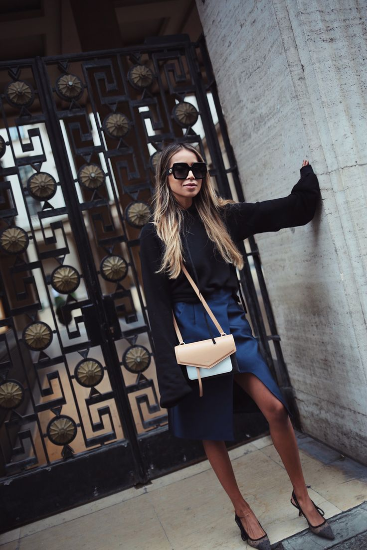 Paris Fashion Week Outfits – Sincerely Jules. Black cropped sweater+dark blue midi skirt+black plumetti pumps+black, camel and white shoulder bag+sunglasses. Fall Dressy Casual Outfit 2017