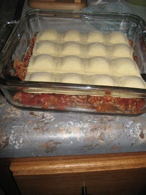 ravioli lasagna, so easy!   This was VERY GOOD!  Huge hit.   I used a whole can of spaghetti sauce instead of 1/2 and it was perfect.