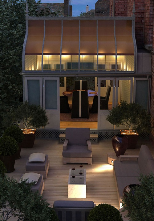 Love this illuminated and uplights in this patio garden -shows just how important the right lighting can be in creating a good ambience.