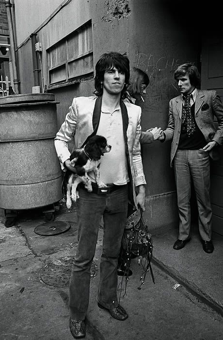 A rare shot shows Keith taking his faithful dog Boogie to a Stones rehearsal in 1971.