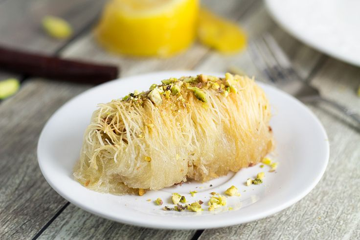 Kataifi is a traditional Greek dessert filled with nuts and covered in a honey syrup. It looks fantastic and will definitely impress your guests!