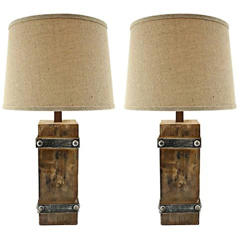 Inspired by rustic farmhouse style, this distressed table lamp set features a warm brown finish with iron-look black bands and burlap shades.