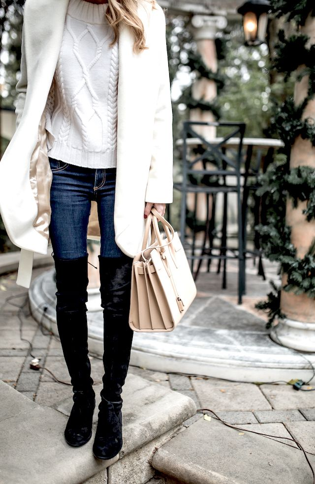 Cream cable knit sweater, coat, skinny jeans, Saint Laurent bag, and black suede over the knee boots