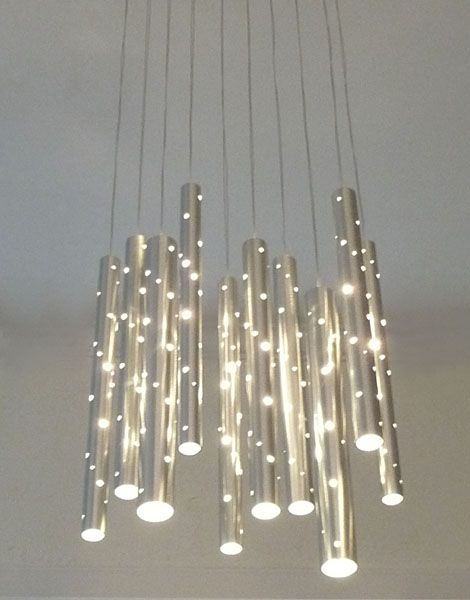 Australian designerIlan Elcreated this beautiful Rain pendant chandelier with the goal of engaging the senses through sight and sound. Rain is an interactive chandlier which doubles as a windchi…