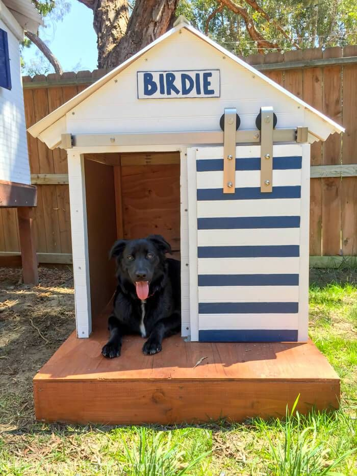 DIY Dog House with sliding barn door -- you can use National Hardware from Tractor Supply!