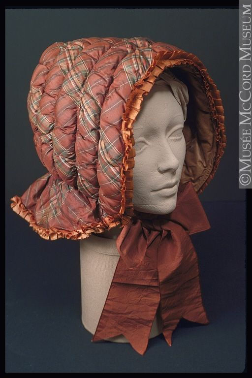 Quilted bonnet (winter), circa 1850, colours would have been brighter when new, note the swallowtail ends oh the wide ties, McCord Museum