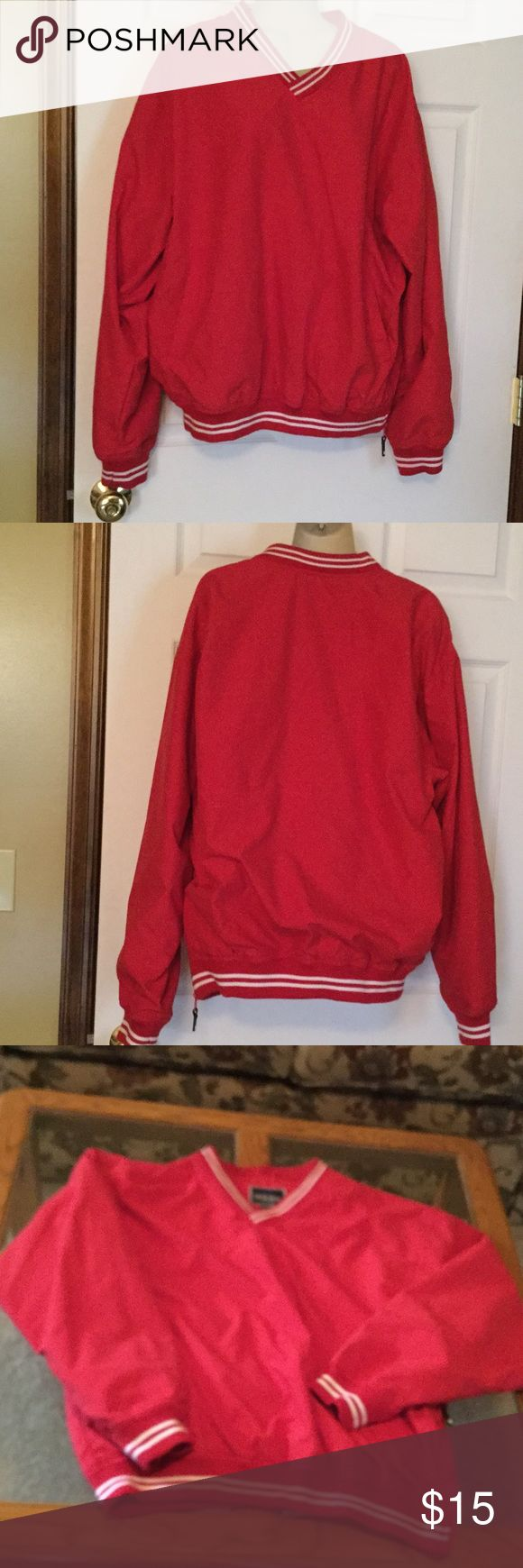 Holloway Men's Lg. Red Windbreaker Top. NWOT 100% polyester shell & Body.  Sleeve lining is 100% nylon. Small v neck with acrylic around neck and arms.  2 pockets in front and a side zipper.  Wind breaker type top has a mesh type lining.  Never worn.  NWOT Holloway Jackets & Coats Windbreakers