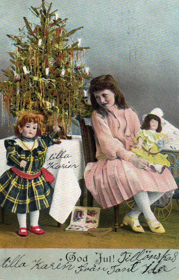 Lilla Karin.  Young girl with two dolls. Christmas tree candles decking out the tree on this early Swedish postcard. www.christmasgiftsfromgermany.com