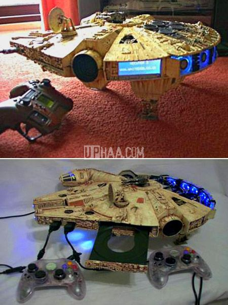 Millenium Falcon XBox 360 mod. Oh. My. God. It is the single most magnificent thing Ive ever seen. http://www.dromelabs.com but the gamepads are original controller s gamepads look at start/select and black/white under B and a ,hmmm