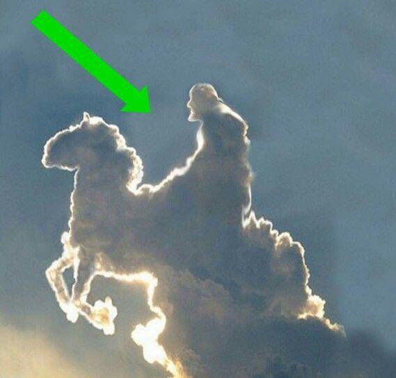 Jesus riding a white horse.