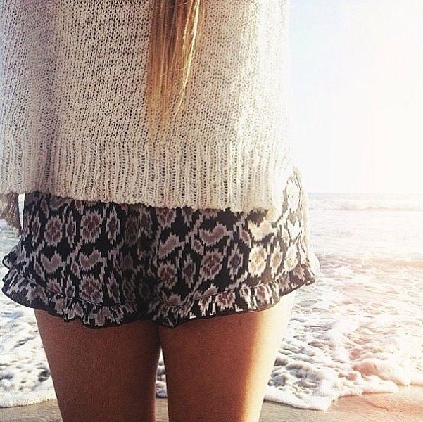 tan/neutral sweater + printed shorts