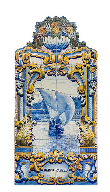 Azulejos in Pinhao Portugal.  Situated at the point where the River Douro and River Pinhão meet, Pinhão is a beautiful place for relaxing, going for walks and discovering the secrets of Port wine in the countless wineries and estates in the surrounding area.