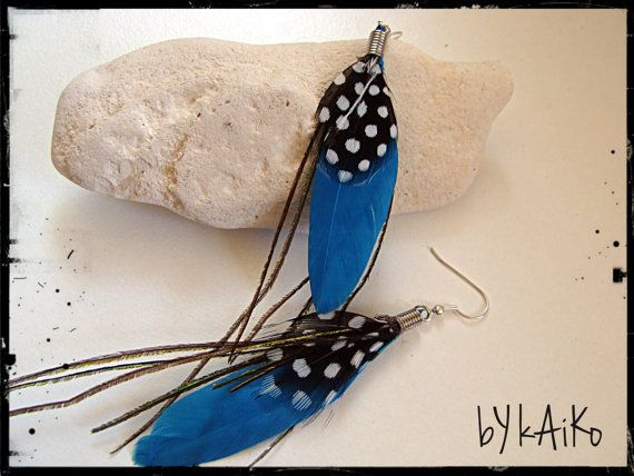 Beautiful soft feather earrings with turquoise rooster feathers on surgical steel ear wires. Wear them everywhere to add that splash of colour and