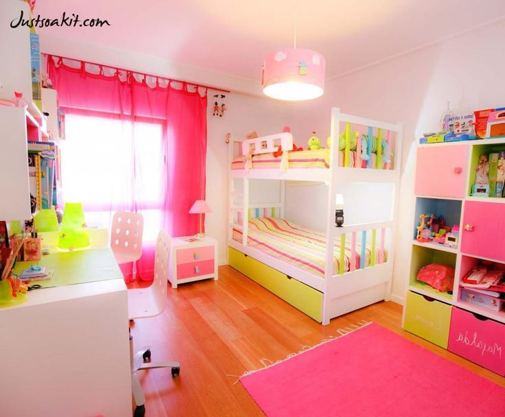 awesome light pink child's room design for two girls with pendant lamp in ceiling including light pink rug on wooden floor as well striped bedding in elegant bunk bed also study table twin chair and pink curtain beside lamp desk