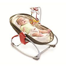 Andrea Cavrag recommends this! Lays down into a bassinet and chair, and it vibrates. babies love that!  Tiny Love 3-in-1 Rocker Napper - Brown