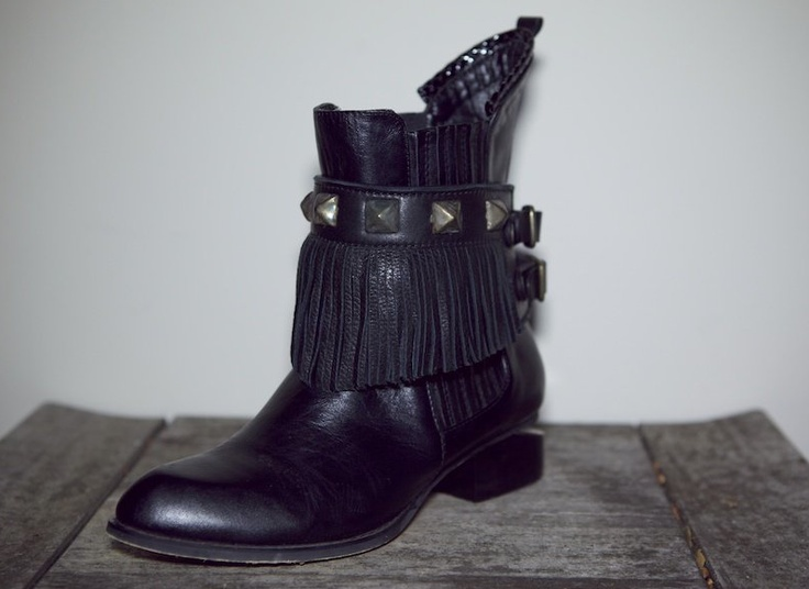 black leather boot harness with gold metal work from shopblixen.com