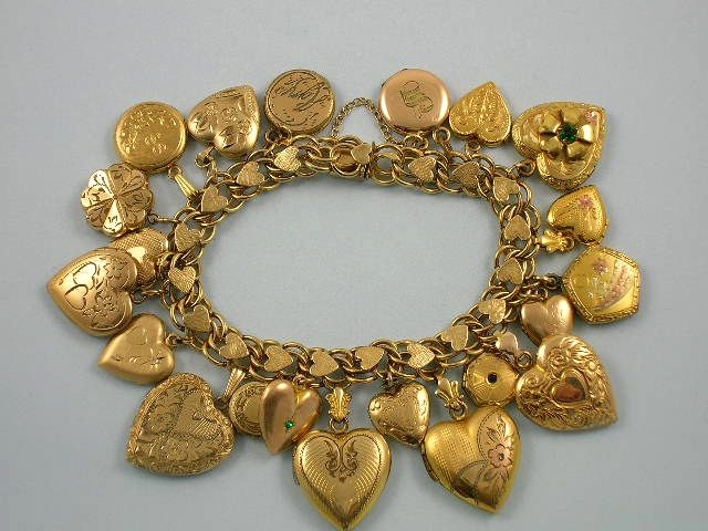 Note the heart shaped links on the bracelet itself. Gold filled heart locket charm bracelet, Victorian to mid 1940's. Include multicolor hearts, jeweled ...