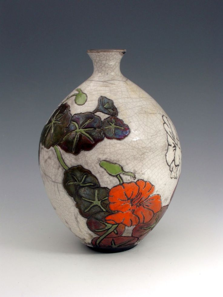 ceramic by JoAnn Axford - i love the colours so much, but I wish it had a wider neck...i don't trust narrow-necked vases!