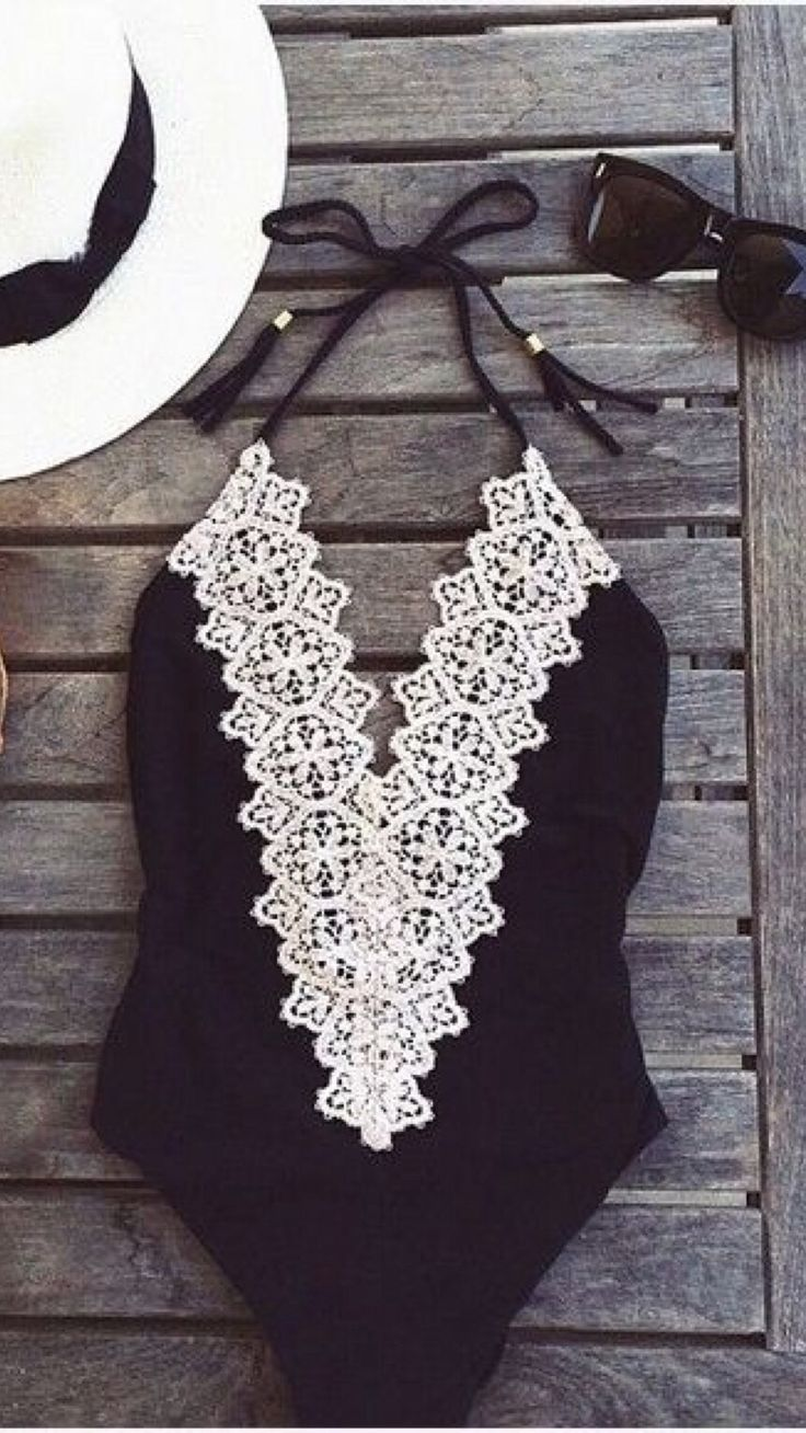 Swimmer. One piece. Black with white lace.