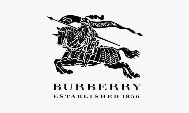 "Burberry Prosum / While the mention of ""Burberry"" invokes thoughts of their eponymous check pattern and their invention of gabardine, it was 1901 when the Burberry Equestrian Knight Logo was developed. Containing the Latin word ""Prorsum,"" meaning forward, many speculate that the knight's armor reflects the companies innovation in the realm of outerwear."