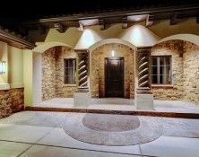 The front entry at night... the lights, the stained concrete, the braided pillars, welcome home.  #Boise #Idaho, homes for sale, home builders