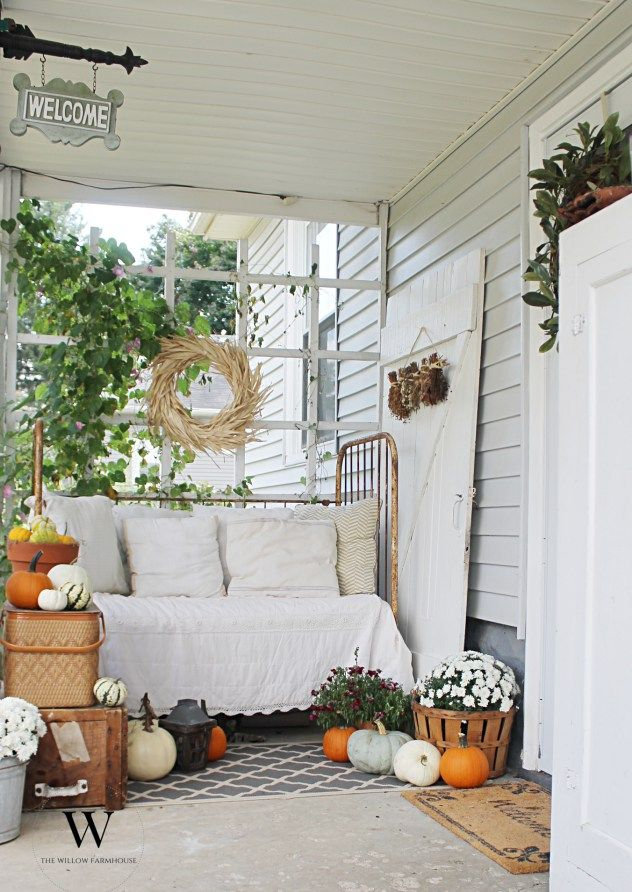 Fall Decor On A Beautiful Farmhouse Porch