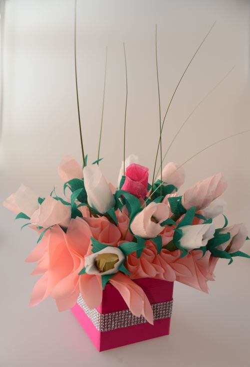 Paper rosebuds with Ferrero Rocher centres. Perfect for a table centrepiece at a wedding or a great anniversary or birthday gift