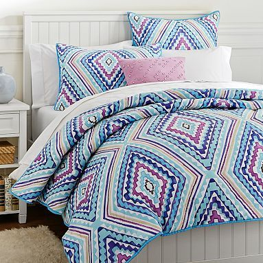 Katie- cute quilt  with navy and purple accents and linen walls Kaleidoscope Quilt Quilt + Sham #pbteen