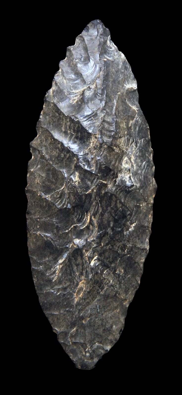 """Flint Blade. During the Stone Age, flint tools were made by """"knapping."""" A process where one hard object is used to strike another hard object such as flint stone to create a shape or form. Flint was a natural choice as it splits when struck forming sharp splinters called flakes or blades. Location: Guerrero State, Mexico 