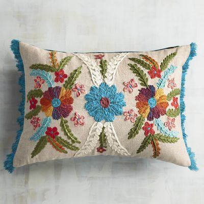 This isn't your grandmother's embroidered floral pillow. No, our colorful pillow has a distinctly global, independent, beautiful vibe. It's heirloom-worthy, but it also has bazaar appeal—something for every generation and personality to appreciate.