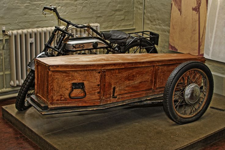 Norton Motorcycle and side coffin at the Norfolk Rural Life Museum. Possibly the oldest motorcycle hearse.