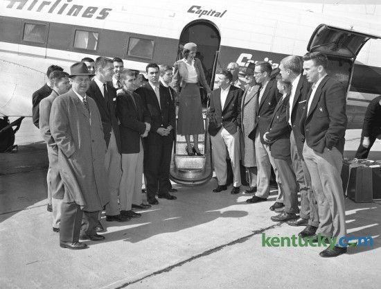 University of Kentucky (UK) basketball team arrived at Blue Grass Field March 2, 1954, after completing the regular season without a defeat.  The traveling party for the two-game trip to Auburn and Alabama included (not in order) Assistant Coach Harry Lancaster, Bill Bibb, Linville Puckett, Cliff Hagan, and Frank Ramsey, Peggy York (center, hostess for Capital Airlines), Gayle Rose, Coach Adolph Rupp, Bill Evans, Student Manager Mike Dolan, Willie Rouse, and Dan Chandler, Harold Hurst, Phil…