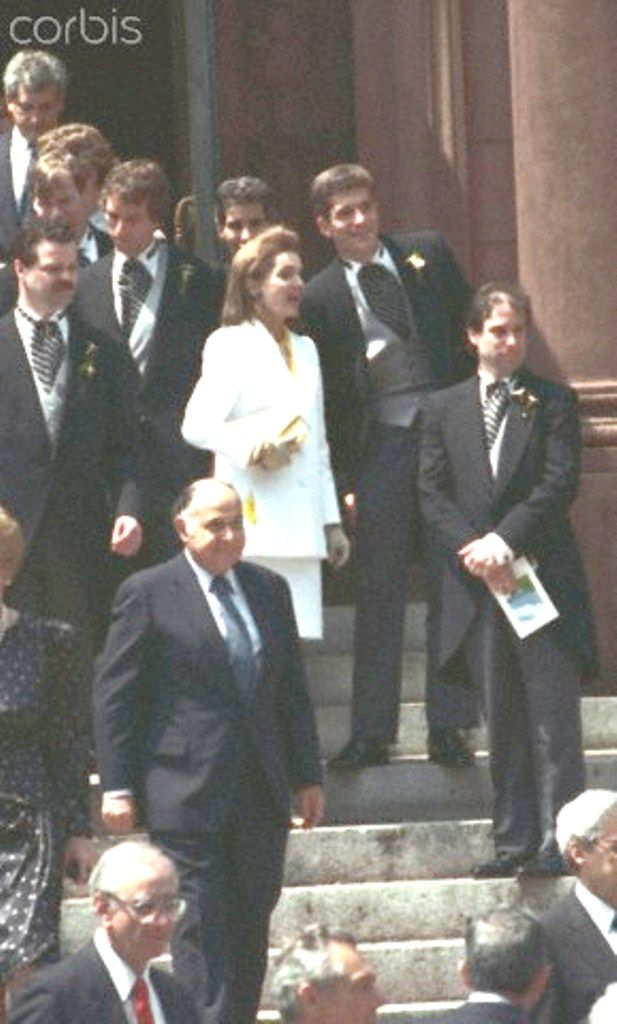 Jacqueline Kennedy Onassis and John F. Kennedy Jr. at Wedding Ceremony Original caption: Washington: Jackie Onassis shares 6/9, a comment with her son, John F. Kennedy Jr., as the two leave St. Matthew's Cathedral after the wedding of Kerry Kennedy and Andrew Cuomo.  Date Photographed:June 09, 1990.   http://en.wikipedia.org/wiki/Jacqueline_Kennedy_Onassis    http://en.wikipedia.org/wiki/Kerry_Kennedy   ❤❤❤