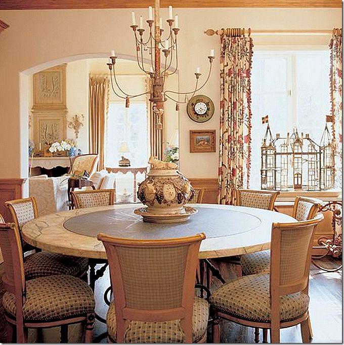 Charles Faudrée dining room with printed fabric curtains.  Love the tole clock.