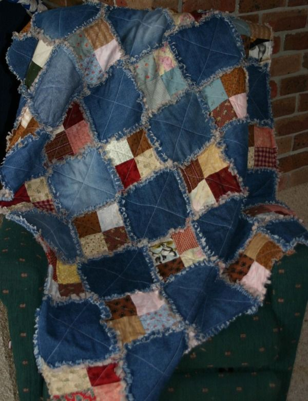 Denim and print fabric scrap quilt. A great way to upcycle some of the stuff I've got from Goodwill!:
