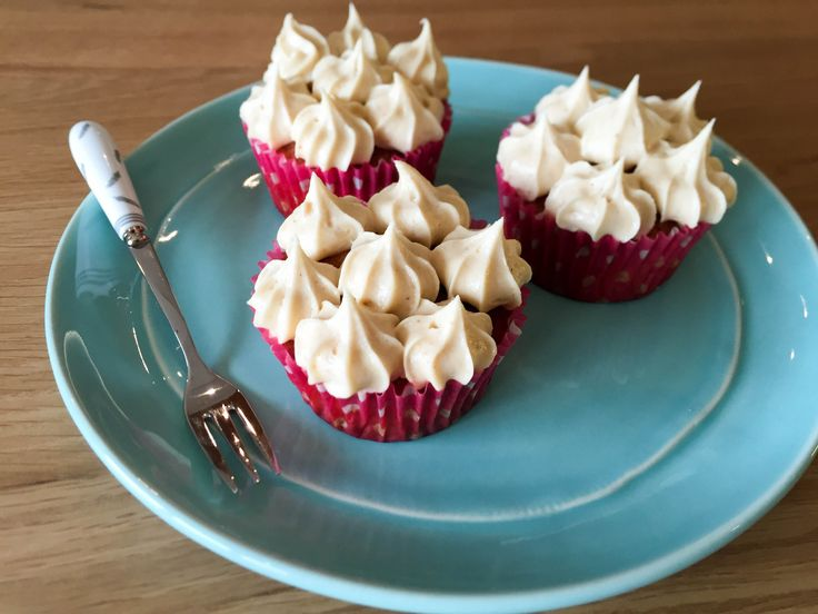 Banana & Peanut Butter Cupcakes! Sweet banana cakes, topped with a decadent creaming icing! Perfect for indulgence.