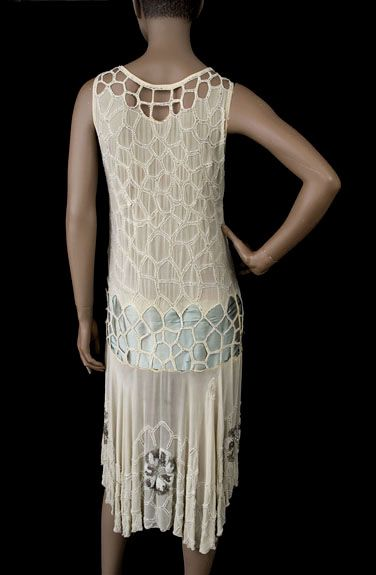 Beaded chiffon flapper dress, 1920s Beaded dresses from the early 20th century have a luxe beauty not found in contemporary copies. You will never be scratched by sharp jagged edges on antique beads. The dress is made from cream colored silk chiffon. The torso is embellished with a cobweb style design of white glass beads—some opaque and some clear crystal. Back