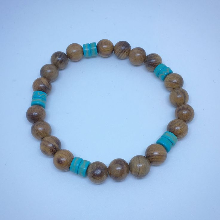 A personal favorite from my Etsy shop https://www.etsy.com/ca/listing/575326166/agarwood-and-turquoise-bracelet-wooden