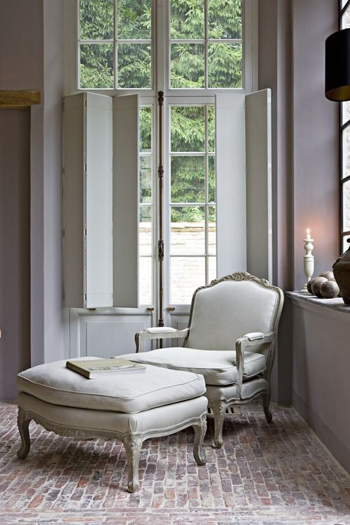 Lovely reading spot...love the French chair and ottoman...similar to the one in our family room. Ottoman can become extra seating or substitute for a table on which to set books etc.