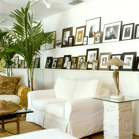 Create a Family Gallery, use one wall to display photos on a shelf - easy to change up the pictures!