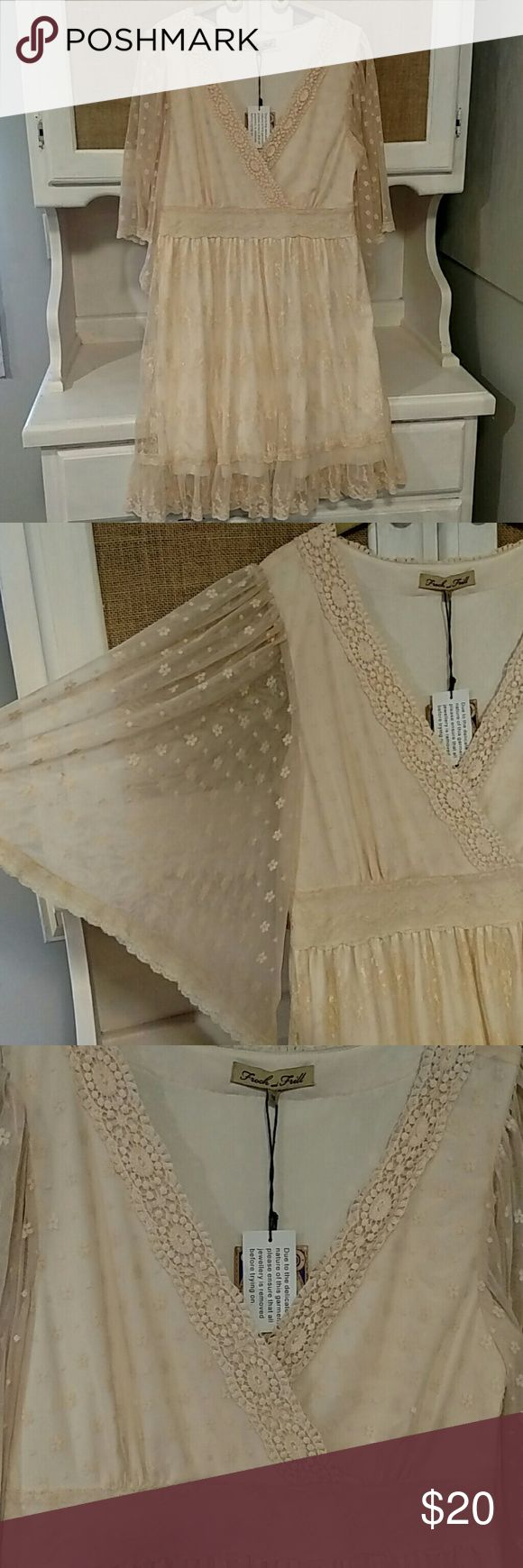 """Frock and frill dress Lace and so flowy and girly. Says size 14 but it is not it runs small I would say 10-12 for best fit. Chest is 18"""" under bust is 16"""" has a side zipper and length is 36"""". Still has tags attached. Would make a great bridesmaid dress or wedding shower dress etc....pics really don't do it justice its gorgeous! Dresses Mini"""