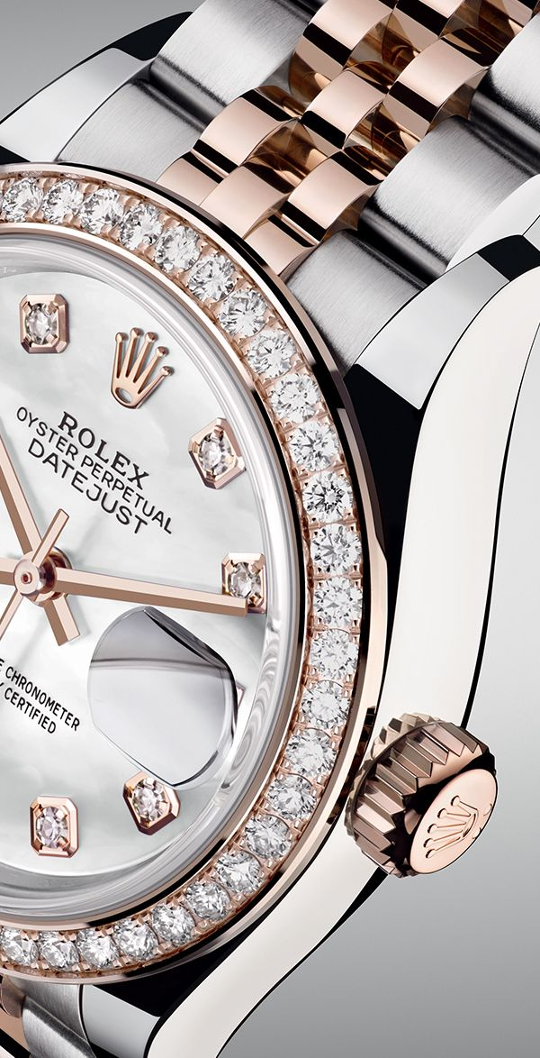 The Rolex Lady-Datejust 28 in Everose Rolesor with a diamond-set bezel and a white mother-of-pearl dial.