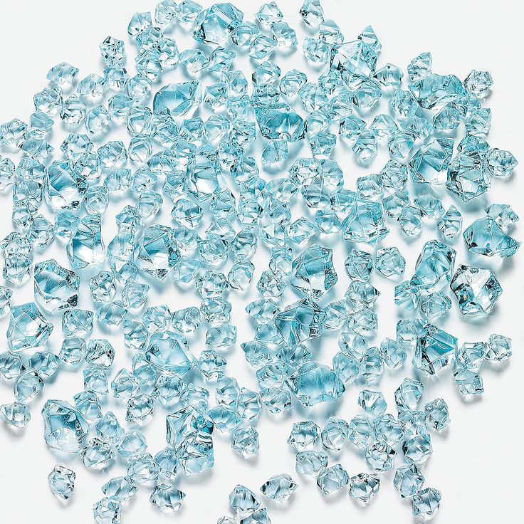 """Blue Ice. Make any centerpiece shine with these bits of faux blue """"ice"""". Sprinkle this magical acrylic ice on your wedding reception tables. (Approx. 225 pcs. per unit) 3/8"""" - 1"""""""