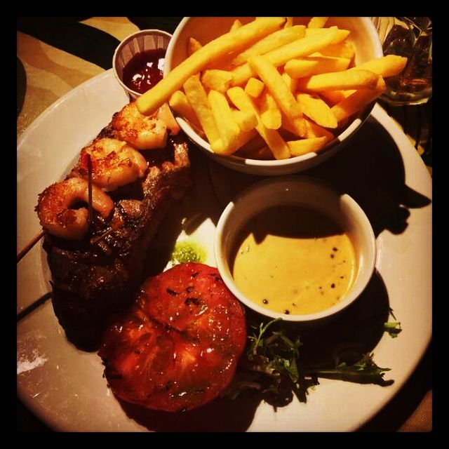 Our Primal Steak: 12oz sirloin steak char grilled to perfection, with peppercorn sauce! Served with mash or fries PLUS add 3 tiger tail prawns for just £1.95!