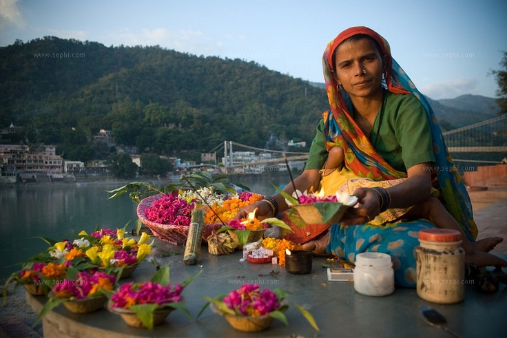 Flowers to set afloat on the River Ganges--you see them like bright jewels floating past in the murky gray water