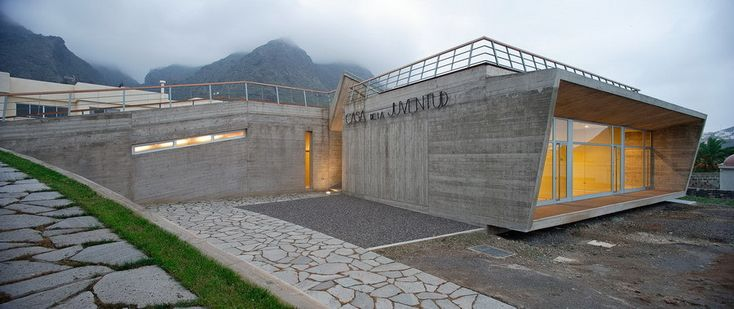 Built by Lavin Arquitectos in Los Silos, Spain with date 2002. Images by Miguel de Guzmán. The concrete plane like a tectonic plate, folds the land and incorporates, by way of an embracing gesture, a recreati...