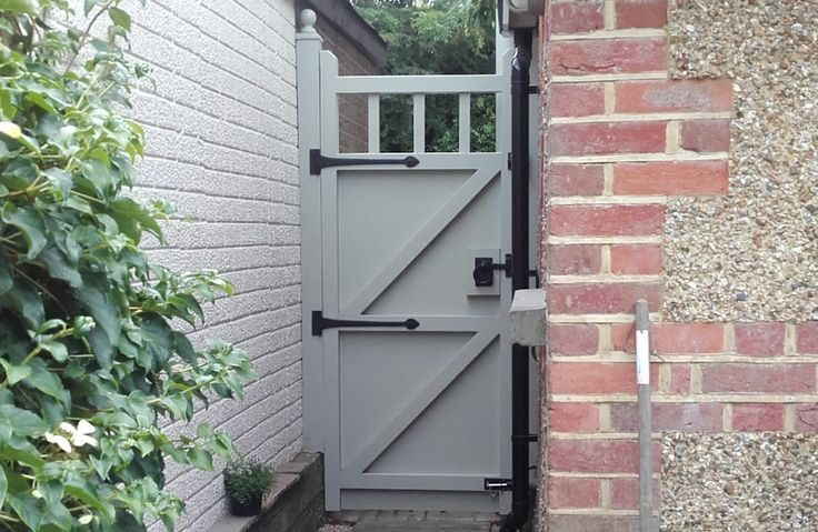 Painted garden gate. Approx 6ft high fitted with decorative hinges and opening. Rear view showing the structural bracing positions required to secure the gate in place.