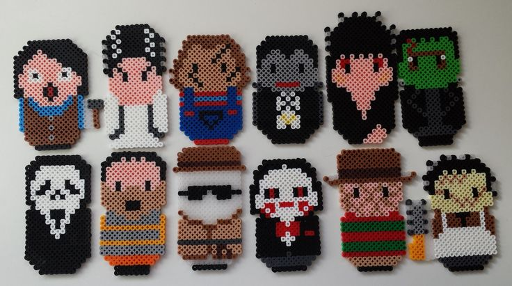 Perler horror alphabet A-L:  Annie Wilkes, Bride of Frankenstein, Chucky, Dracula, Elvira, Frankensteins' Monster, Ghost Face, Hannibal Lecter, Invisible Man, Jigsaw, Freddy Krueger, Leatherface - by Joanne Schiavoni