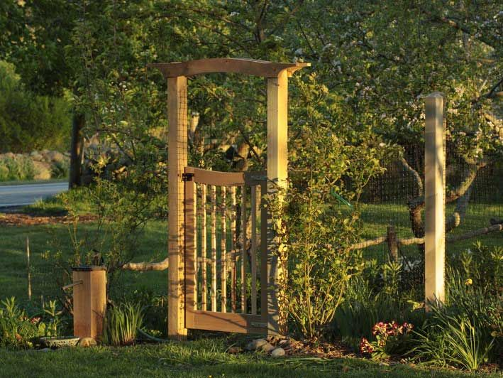 wooden arched arbor and garden gate