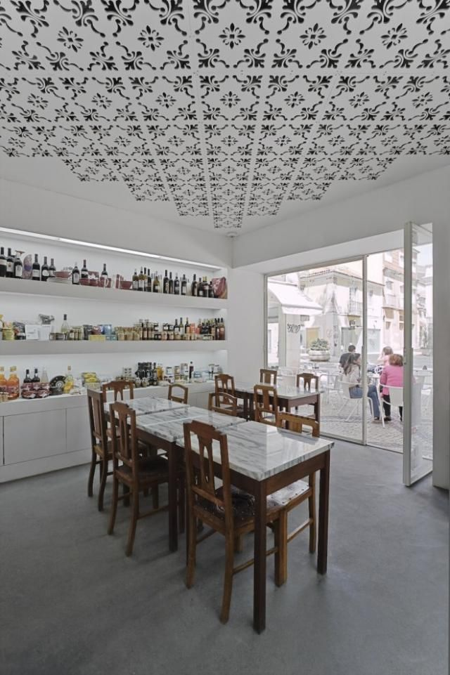 Obsessed!...Innovative laser cuts create an enchanting lace effect on the ceiling of Fugas Lusas, a cafe and purveyor of comestibles in Sétubal, Portugal.
